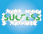 Partial jigsaw puzzle spelling the word success