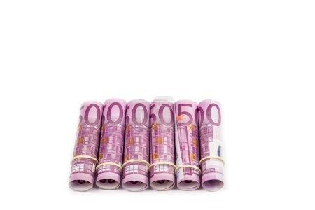 Photo pour Billets en euros enroulés en arrière-plan isolé - image libre de droit