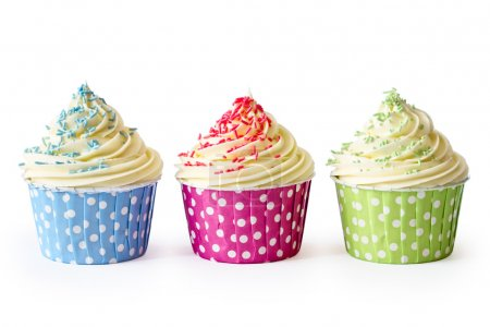 Photo for Colorful cupcakes against a white background - Royalty Free Image