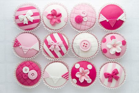 Photo for Pink and white cupcakes, overhead view - Royalty Free Image