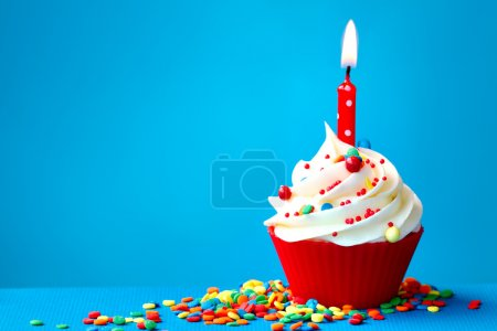 Photo for Cupcake decorated with a single candle - Royalty Free Image