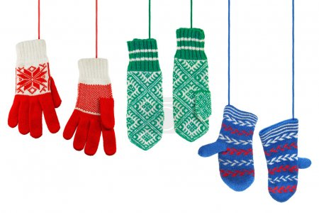 Photo for Three pairs of woolen knitted mittens on a white background - Royalty Free Image