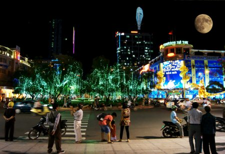are walking at night on January, 18 in Ho Chi Minh City, Vietnam