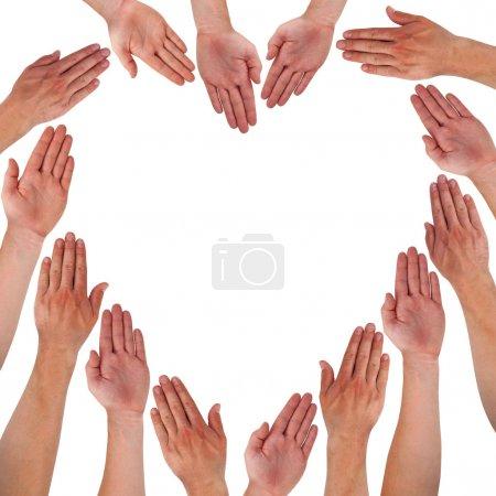 Photo pour Mains formant un cœur isolé sur blanc - image libre de droit