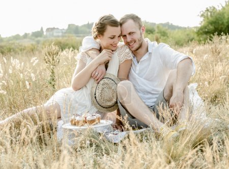 Photo for Happy couple embracing and laughing - Royalty Free Image