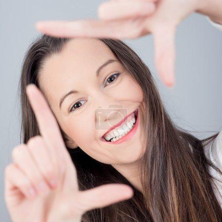 Woman making frame gesture