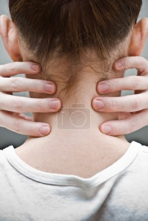 Woman has pain in a neck