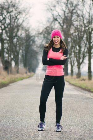 Photo for Runner - woman running outdoors training for marathon run - Royalty Free Image