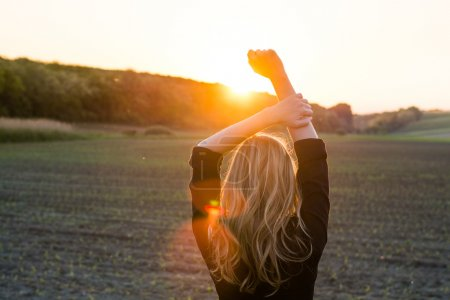 Photo for Young woman enjoys sun beams - Royalty Free Image