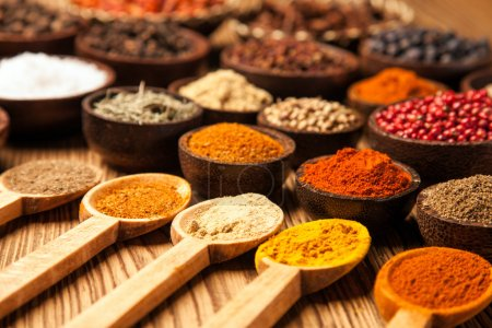 Photo for Spices and herbs in wooden bowls. Food and cuisine ingredients. - Royalty Free Image