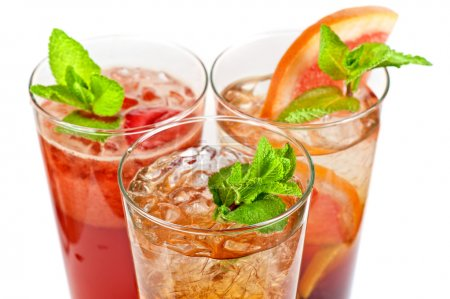 Photo for Set of fresh cold tea with fruits, berries and ice on white - Royalty Free Image