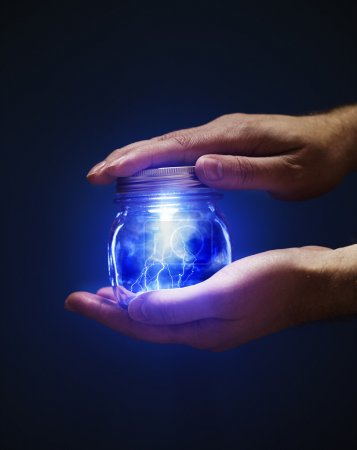 Photo for Conceptual image of a man holding a jar with lightnings in his hands. - Royalty Free Image