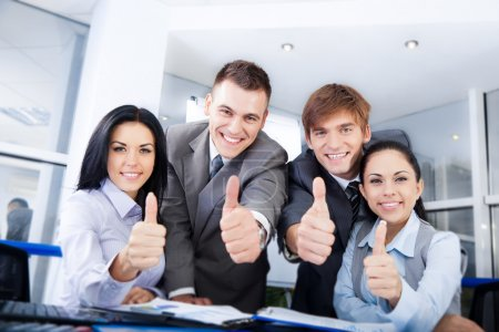 Photo for Business group team hold point thumb up finger gesture at you, Successful excited young businesspeople happy smile at office desk - Royalty Free Image