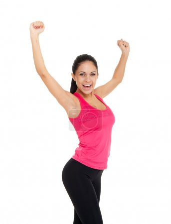 Sport fitness woman excited happy smile hold raised arm hand up