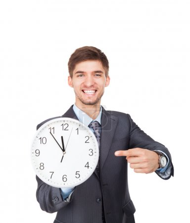 Businessman hold show clock point finger on it