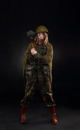 Army girl hold shovel
