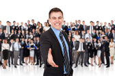 Businessman hold hand welcome gesture