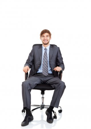 Photo for Businessman happy smile sitting in chair, business man wear elegant suit and tie isolated over white background - Royalty Free Image