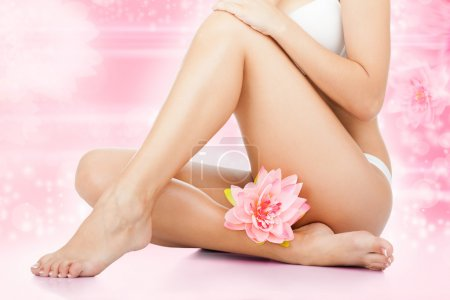 Beauty spa women legs wax, body bikini