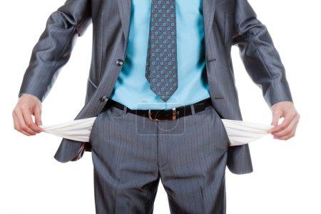 Businessman showing empty pocket