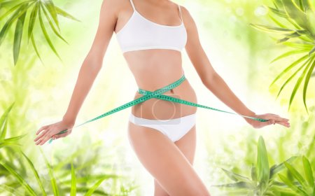 Woman measures waist