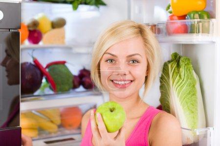 Woman hold fresh green apple