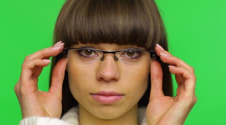 Tired woman taking off glasses