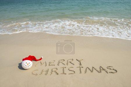 Merry Christmas written on tropical beach white sand with xmas s