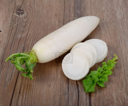 Daikon radish on the wood background...