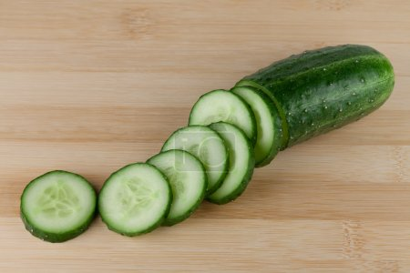 Photo for Cutting cucumber on cutting board - Royalty Free Image