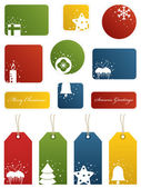 Seasonal christmas labels and gift tags with motifs isolated on white