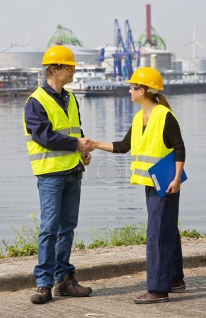 Two Dockers shaking hands