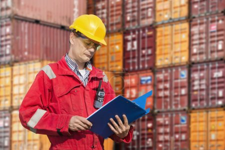 Photo for Docker checking consignment notes - Royalty Free Image