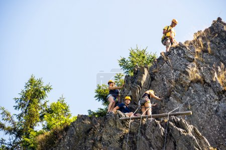 Photo for Low angle view of climbers climbing on rock - Royalty Free Image