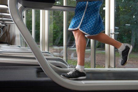 Low section of man on treadmill