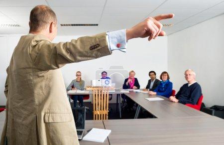 Entrepreneur Giving Presentation To Colleagues