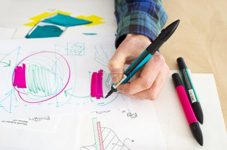 Photo for Left handed designer making a rough sketch of a system solution during the product design process - Royalty Free Image