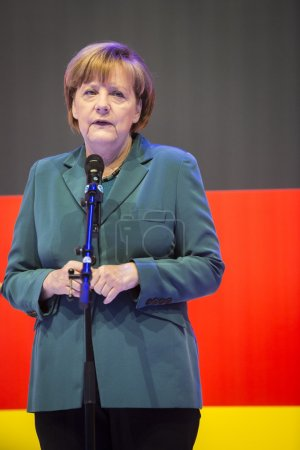 Angela Merkel holding a speech in front of the German flag