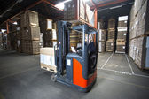 Reach truck is piling up pallets