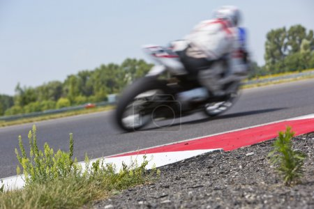 Motorcycle racer on circuit