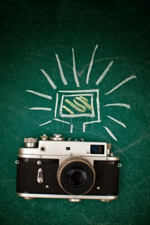 Photo for Retro style camera on a wooden table plate - Royalty Free Image