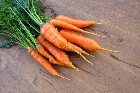Photo for Fresh organic carrot on the wooden table - Royalty Free Image