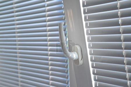 Venetian blinds on window