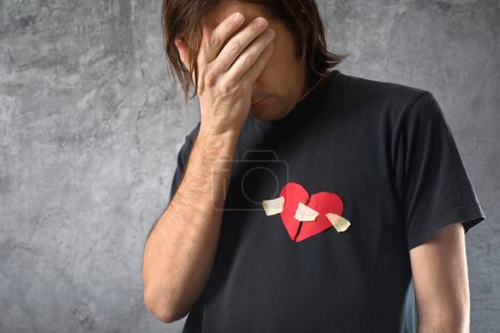 Broken hearted man is crying. Valentines day concept.