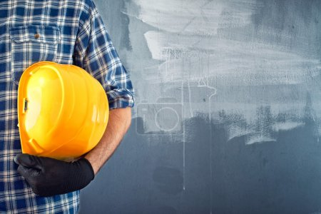 Photo for Construction worker is working on construction site - Royalty Free Image