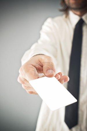 Businessman holding blank credit card
