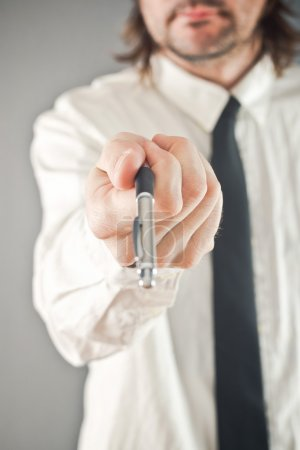 Photo for Businessman offering pencil for contract signing, selective focus on hand - Royalty Free Image