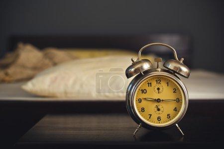 Vintage alarm clock in bedroom
