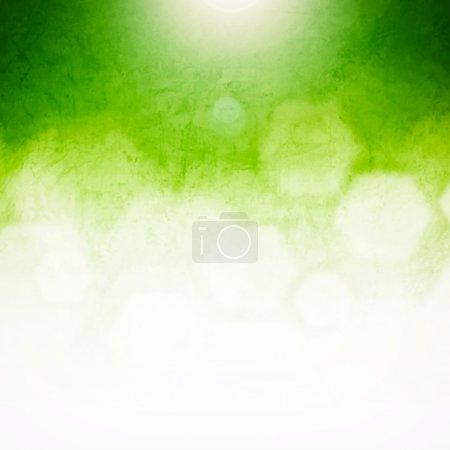 Foto de Fondo abstracto verde brillante brillante en forma de bokeh con textura grunge - Imagen libre de derechos