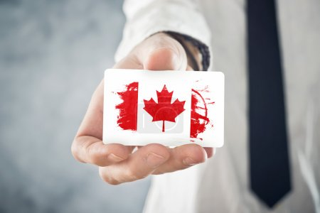 Canadian Businessman holding business card with Canada Flag